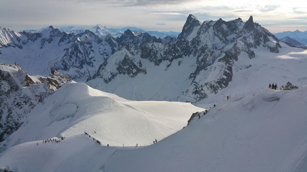 Speed riding launch in the shadow at the end of the arête