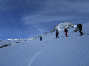 Skinning to top of Grands Montets... it is uncontrolled backcountry without the cable car