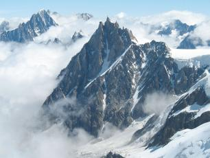 The Aiguille du Midi 3842m peak in the Mont Blanc massif of the French Alps