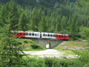 Mont-Blanc Express running along the Ligne de Saint Gervais – Vallorcine near Chamonix, France.