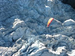 Paragliding above the Chamonix glaciers and seracs