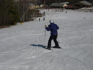 The beginners typical position when he starts skiing!