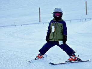 A young ski beginner in Chamonix ski resort