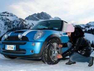 Woman fitting Snow Chains